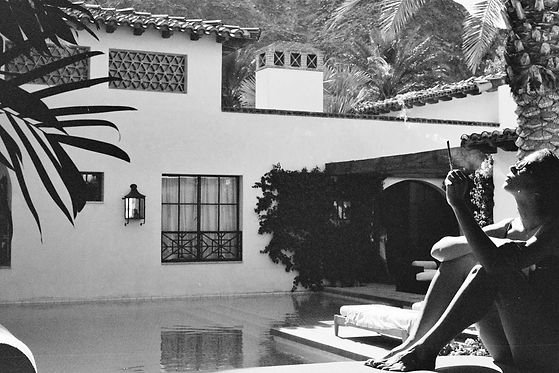 Woman Smoking Joiant by Pool