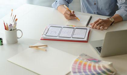 young-designer-working-on-smartphone-app