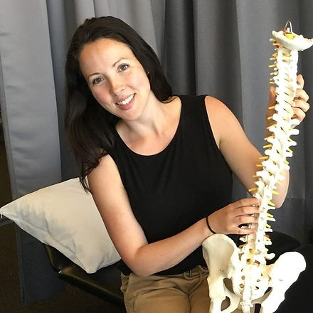 Anne-Marie Mougeot holding a spine model