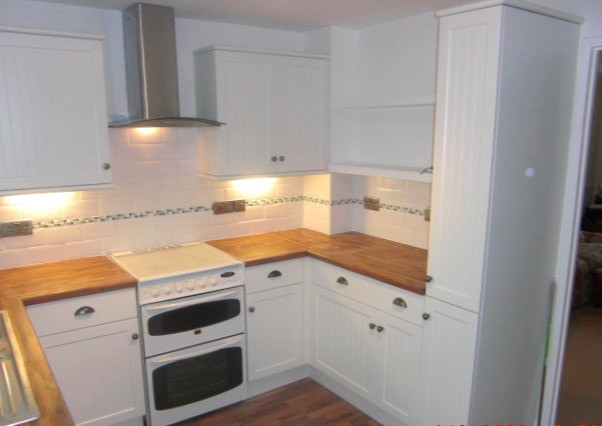 Kitchen installation with white units