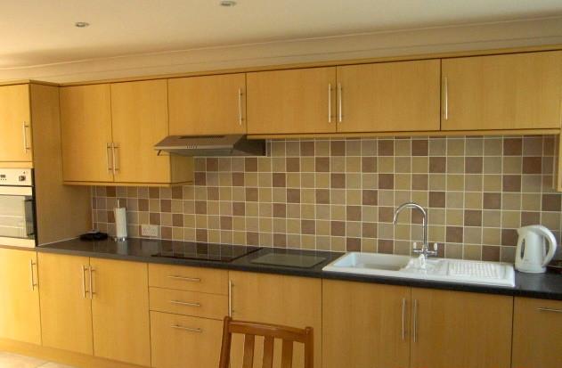 Kitchen installation with wooden units