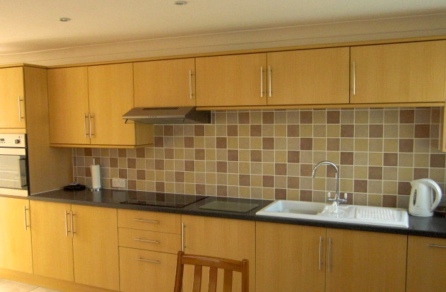 Kitchen installation with wooden units