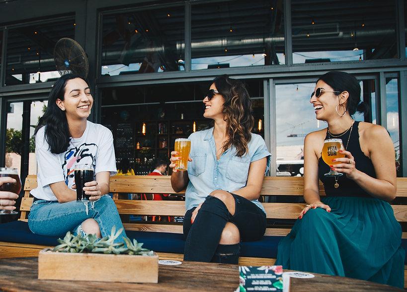 three-women-sitting-on-bench-1267244 (1)