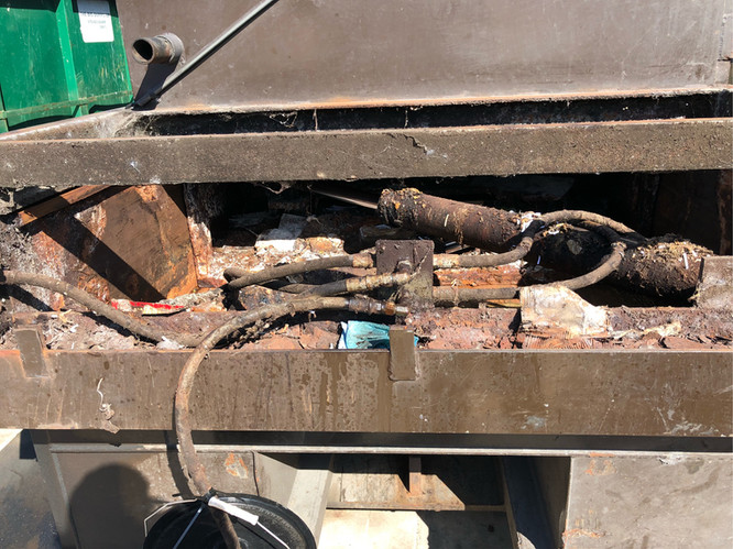 compactor before cleaning.jpeg