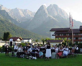 The DMV playing in front of mountains in Germany.