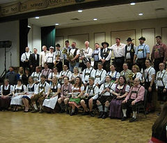 German polka band posing for a picture.