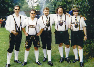 Five guys in lederhosen.