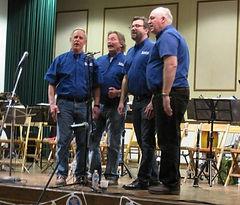 Men's Barbershop Quartet performing.