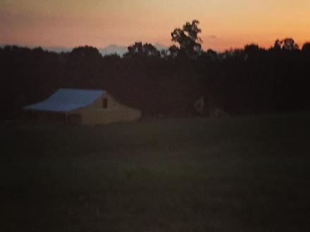 Sunset behind the event barn. Still under construction but we are almost there!! The sun sets right behind the wedding lawn
