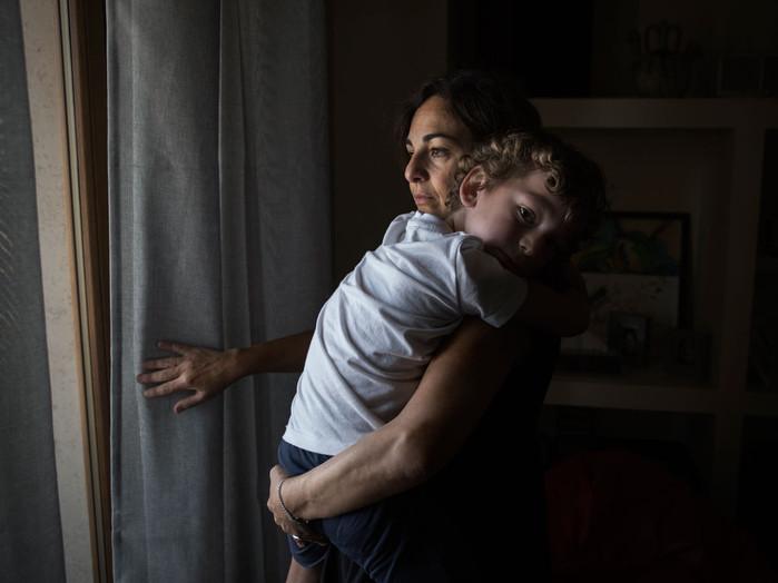 """Sacco river Valley, Colleferro (Rome). Marica, portrayed with her son, is a member of """"Moms Colleferro Association"""" which has been fighting to protect children's health and the environment. ---- Valle del Sacco, Colleferro (Roma). Marìca, ritratta con suo figlio, fa parte di """"Associazione Mamme Colleferro"""" che dal 2010 si batte per tutelare la salute dei bambini."""
