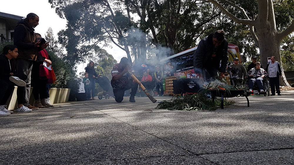 A sacred 'smoking ceremony' conducted by Uncle Shane and Uncle Mike of the Bunurong people. 'Walk together, treading softly, gently and carefully, in treaty and reconciliation with the land and its First People.'