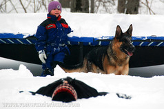 German Shepherd dogs with kids in the snow