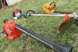 Hand held lawn equipment laying in grass