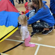 Volunteer helping child.jpg