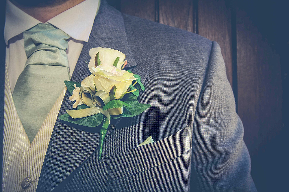 How to attach a wedding buttonhole or corsage