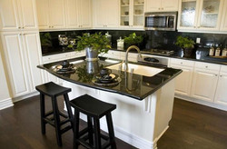 Absolute Black with White Cabinets