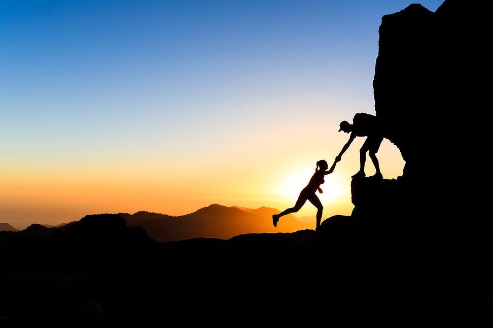 teamwork-couple-climbing-helping-hand-PX