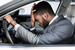 stressed-businessman-feeling-headache-in
