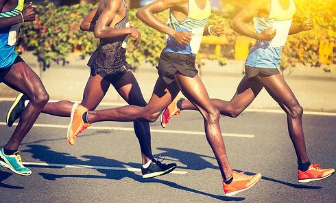 marathon runners running on city road.jp