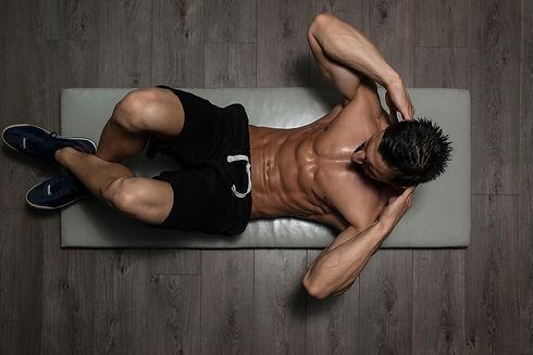 Healthy Man Exercising Abdominals On Foo