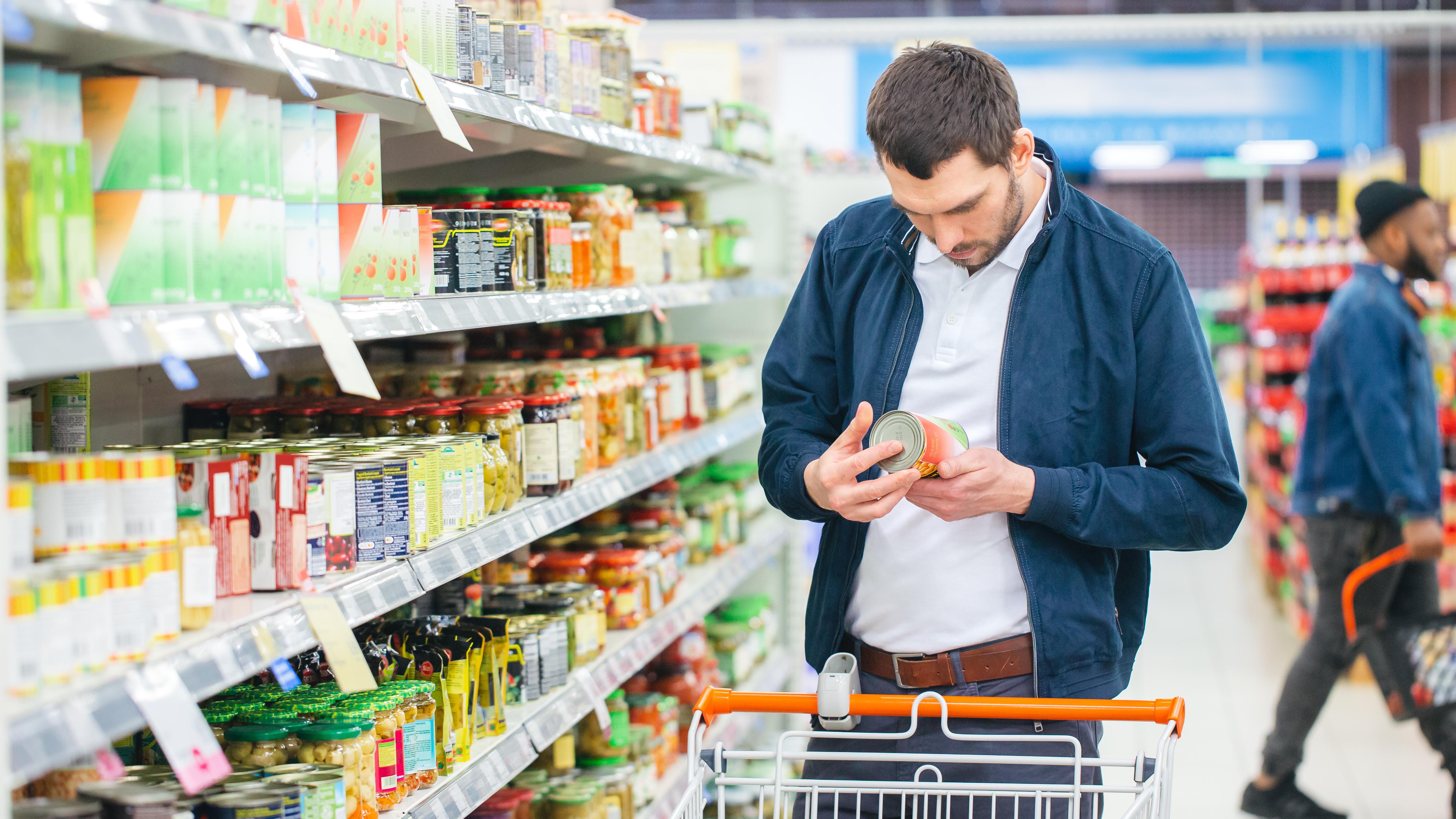 At the Supermarket: Handsome Man Uses Sm