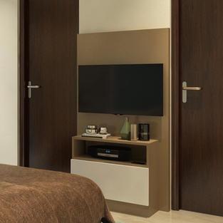 Sleek tv unit sits smartly between 2 doors