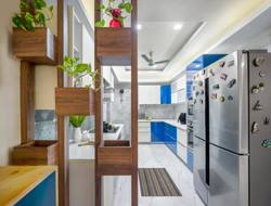 Blue-o-file :U shaped kitchen with planters