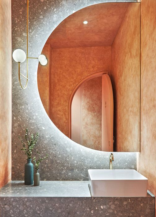 lighting around looking mirror. customised bathroom designs. bathroom designing tips. lakkad works