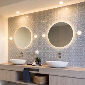 lighing position around the looking mirror. bathroom designing tips. lakkad works
