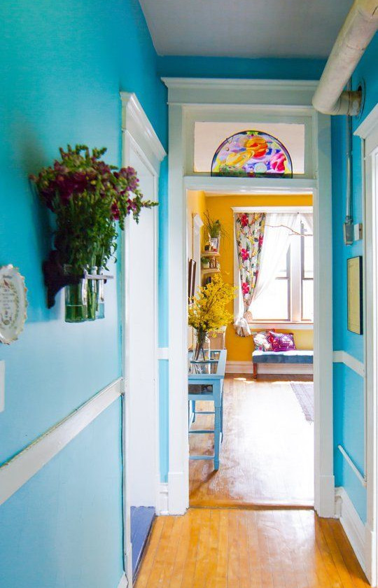 hallway painted with bright and cheerful colours. adding character to hall way. Interior designing by lakkad works, cheerful coloured hallway