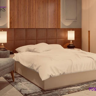 Bedroom with wood panelled and cushioned bed back