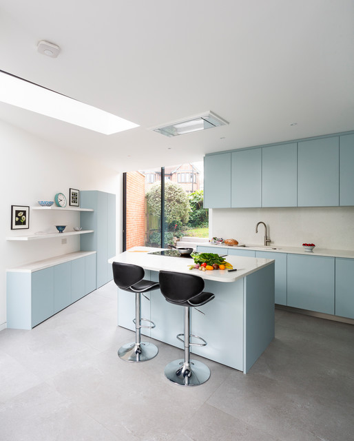 a soothing modular kitchen designed in pastel colours