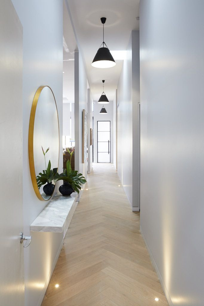 layout consideration for hallway, placing mirror in hallway to add character to it. interior designing by lakkadworks
