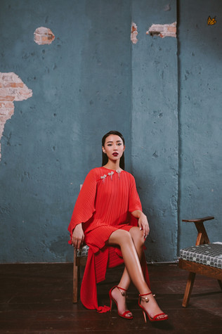Deconstructed high-low kaftan with cape