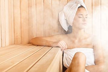 Young woman relaxing in sauna.jpg
