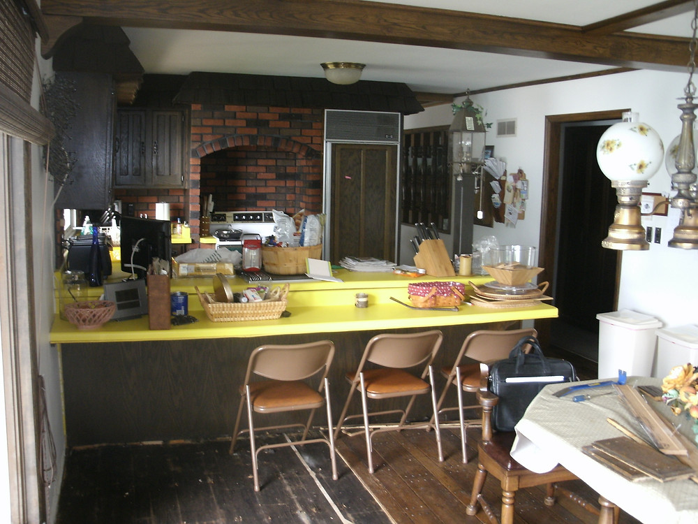 Dark kitchen with yellow tops