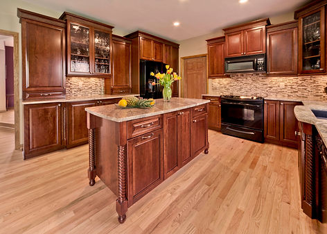 Cherry kitchen with furniture accents