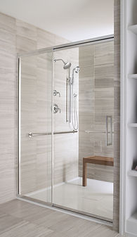 Custom shower with 12x24 tile walls, contemporary grab bars, glass enclosure