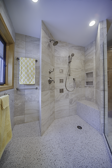 Walk in doorless shower with body sprays