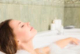 Woman relaxing in bath.jpg