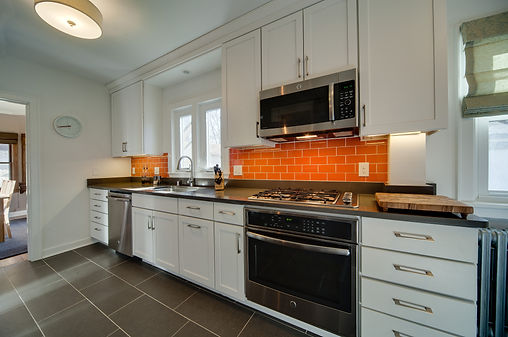 White shaker kitchen with red backsplash tile