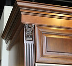 Multi piece crown molding stacked with fluted column and decorative corbel.