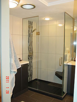 Contemporary tile shower with vertical glass tile accent
