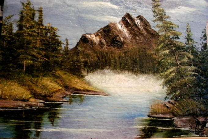 Brown mountain and lake scene