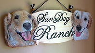 Personal house sign with dog portraits