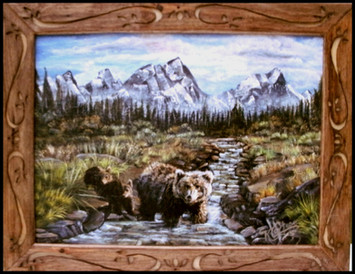 Grizzly bear with cubs mountain and stream scene