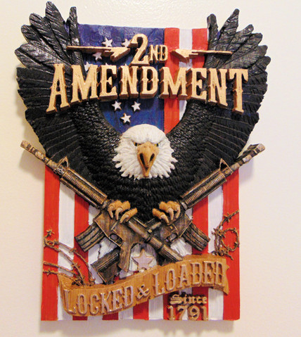 2nd Amendment Eagle Holding Rifles Locked and Loaded