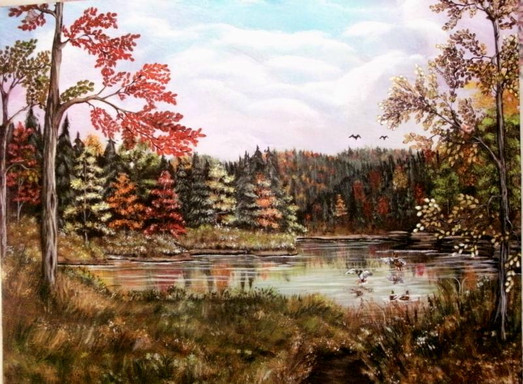 Wilderness lake in the fall with ducks landing in water
