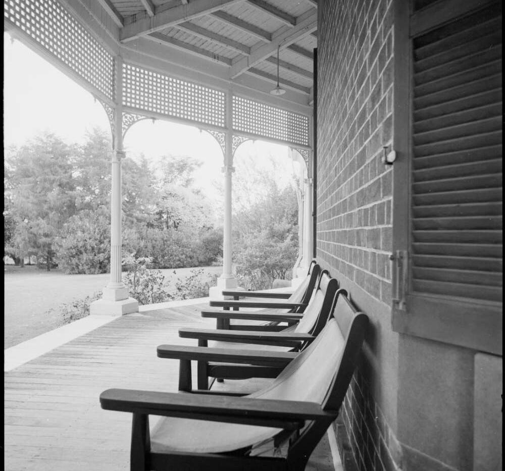 Deck chairs on the lower verandah at Bel