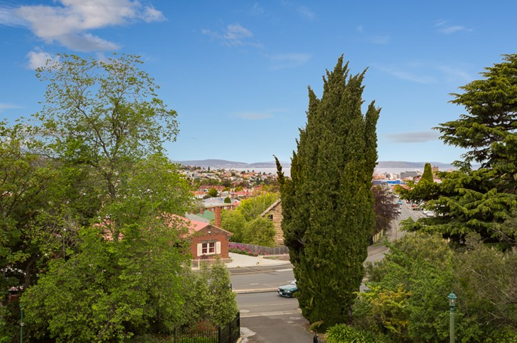 The Elms, a North Hobart Federation Arts and Crafts mansion with views over the extensive gardens and the Derwent River.
